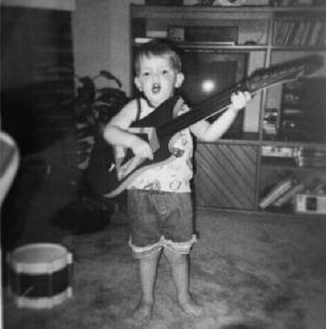 lil James with guitar